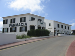 The Farmacia is located next to Smithys bar at the top of the hill from the apartments